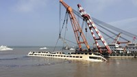 Cranes work on righting the capsized Eastern Star cruise ship at the Jianli section of the Yangtze River, Hubei province, China, June 5, 2015.