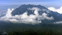 Mount Kinabalu appears through the clouds over Kota Kinabalu, capital of the east Malaysian state of Sabah on Borneo island, in this file photo of Reuters