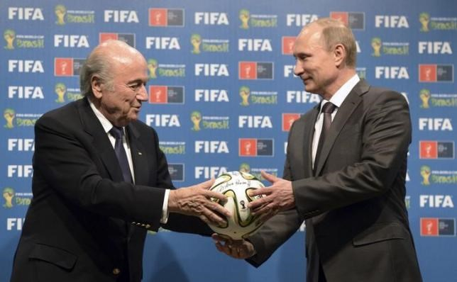 Russia's President Vladimir Putin (R) and FIFA President Sepp Blatter take part in the official hand over ceremony for the 2018 World Cup scheduled to take place in Russia