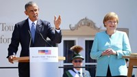 German Chancellor Angela Merkel and U.S. President Barack Obama make speeches after signing the guest book in Kruen, southern Germany, June 7, 2015.
