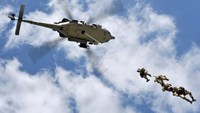 An image released by the Navy Media Content Service shows Navy SEALs demonstrating a special patrol insertion/extraction from an MH-60S Sea Hawk helicopter