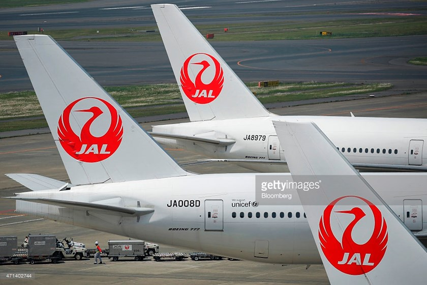Japan Airlines Co. (JAL) aircraft sit parked at Haneda Airport in Tokyo, Japan, on Tuesday, April 28, 2015.