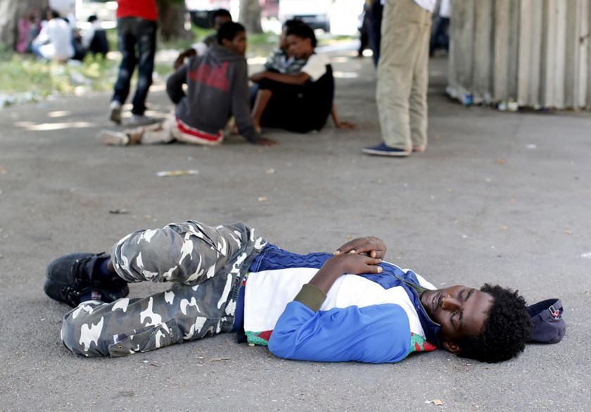 A migrant sleeps on the street next to the Tiburtina station in Rome, June 11, 2015.