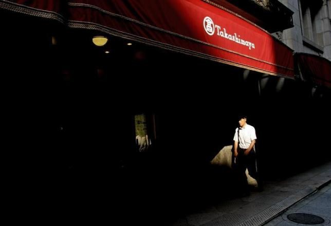 A file photo shows a man walks past Takashimaya department store in Tokyo