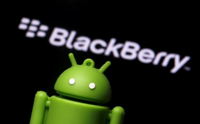 An Android mascot is seen in front of a logo of Blackberry in this photo illustration taken in Zenica, Bosnia and Herzegovina, June 12, 2015.