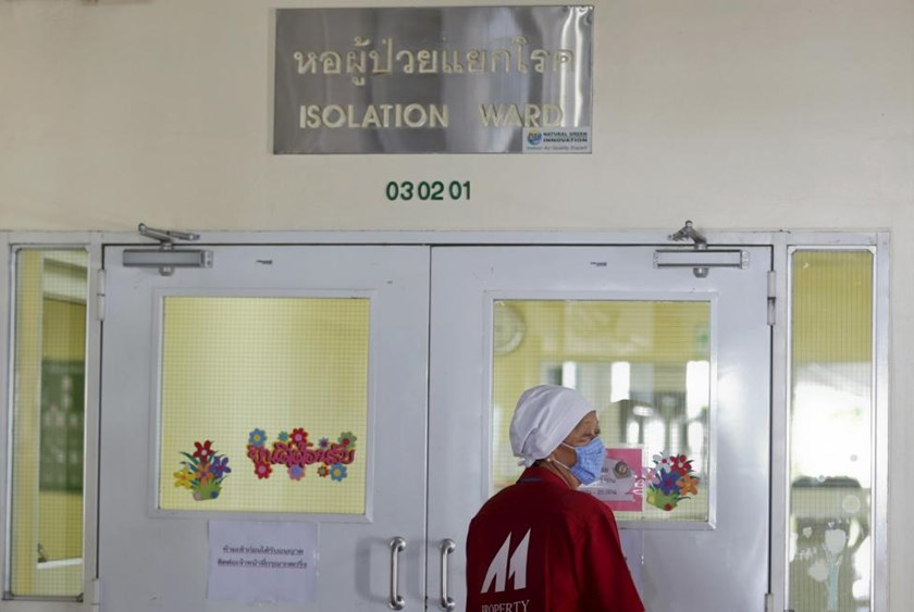 A worker wearing a mask walks outside the isolation ward where a 75-year-old businessman from Oman is being treated for the Middle East Respiratory Syndrome (MERS) at the Bamrasnaradura Infectious Diseases Institute in Nonthaburi province, on the outskirts of Bangkok, Thailand, June 19, 2015.