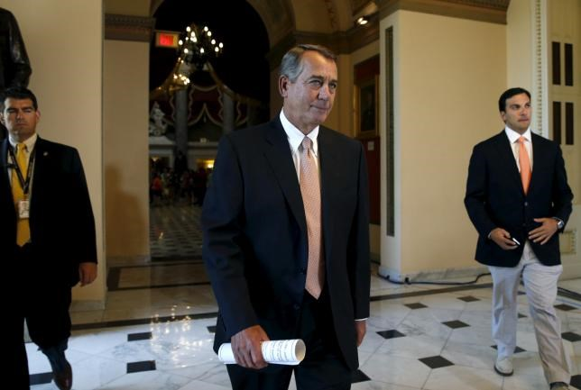 Speaker of the House John Boehner walks to the House Chamber where members of congress were voting on a package of trade bills in the U.S. Capitol in Washington June 12, 2015.