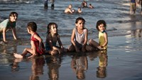 Palestinian children play on the beach on September 7, 2014 in Gaza city. Photo: AFP