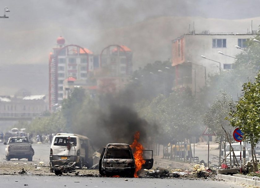 A vehicle is seen on fire after a blast near the Afghan parliament in Kabul, Afghanistan June 22, 2015.
