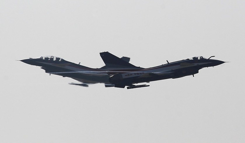 Two J-10 fighter jets fly past each other at China International Aviation & Aeropsace Exhibition in China's Zhuhai