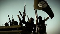 An image grab taken from a video released on March 17, 2014 by the Islamic State of Iraq and the Levant's al-Furqan Media allegedly shows ISIL fighters raising their weapons with the Jihadist flag at an undisclosed location.