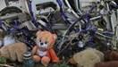 A teddy bear is placed next to wreckage at the site of the downed Malaysia Airlines flight MH17, near the village of Hrabove (Grabovo) in Donetsk region, eastern Ukraine September 9, 2014.