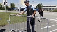 A French Gendarme blocks the access road to the Saint-Quentin-Fallavier industrial area, near Lyon, France, June 26, 2015.