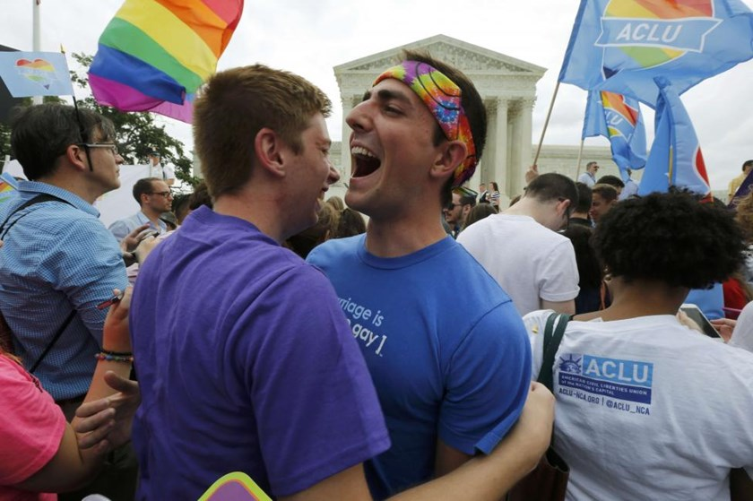 Gay rights supporters celebrate after the U.S. Supreme Court ruled that the U.S. Constitution provides same-sex couples the right to marry, outside the Supreme Court building in Washington, June 26, 2015.