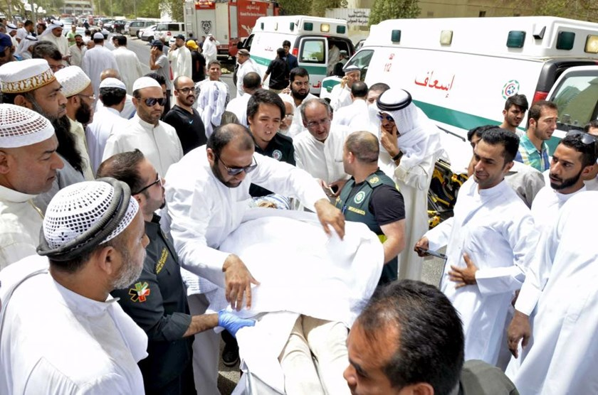 Paramedics rush a victim of a suicide bomb attack at Imam al-Sadeq Mosque, to the Amiri hospital in Al Sharq, Kuwait City, June 26, 2015.