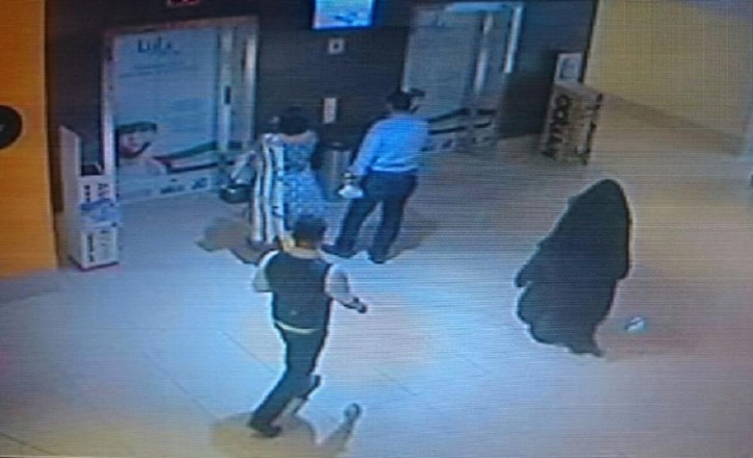 A CCTV image shows a fully veiled woman walking through a shopping mall in Abu Dhabi, the chief suspect in the murder of a US teacher on December 3, 2014
