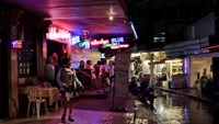 Thai girls stand outside bars in the Patpong red light district in Thailand on May 25, 2010. Photographer: Manish Swarup/AP Photo