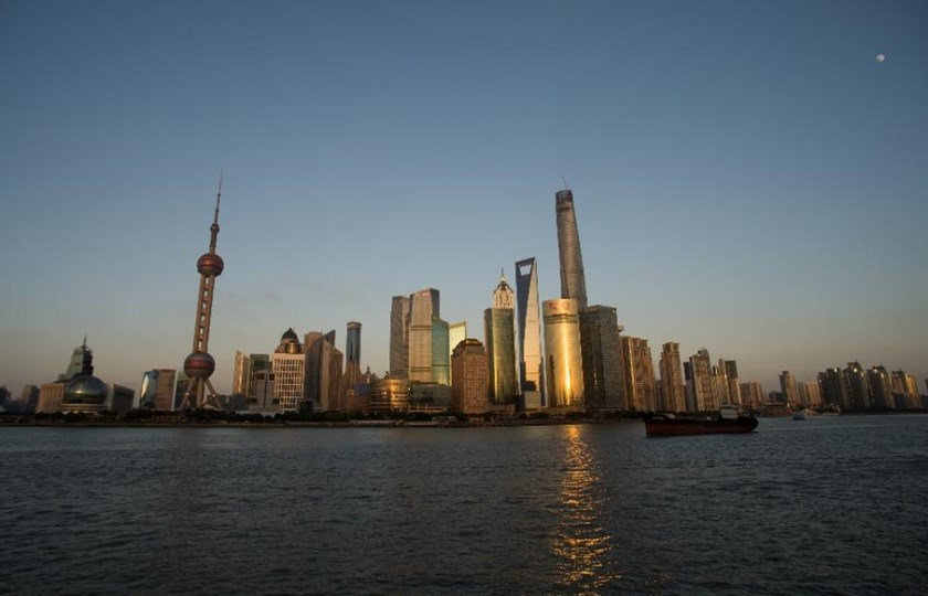 China's three-decade economic boom, which has transformed cities such as Shanghai, is at risk, the World Bank warns, urging reform of state-dominated financial sector.