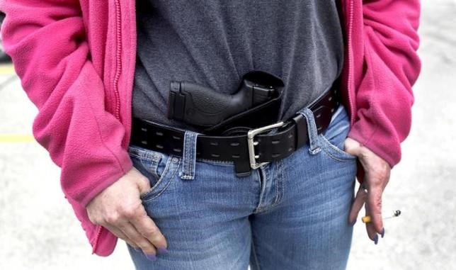 Gloria Lincoln-Thompson carries her 9mm Smith & Wesson pistol in her waist band during a rally in support of the Michigan Open Carry gun law in Romulus, Michigan April 27, 2014.