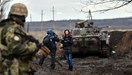 A TV journalist prepares to do a piece to camera in front of an armoured personnel carrier on the frontline between Ukrainian forces and pro-Russian separatists, near Debaltseve, in the Donetsk region