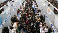 Graduates at a job fair at Tianjin University Sports Arena in China. Photograph: ChinaFotoPress/Getty Images