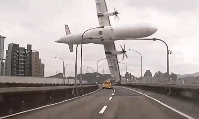 A TransAsia ATR 72-600 turboprop plane clips an elevated motorway and hits a taxi before crashing into the Keelung river outside Taiwan's capital Taipei, in February 2015
