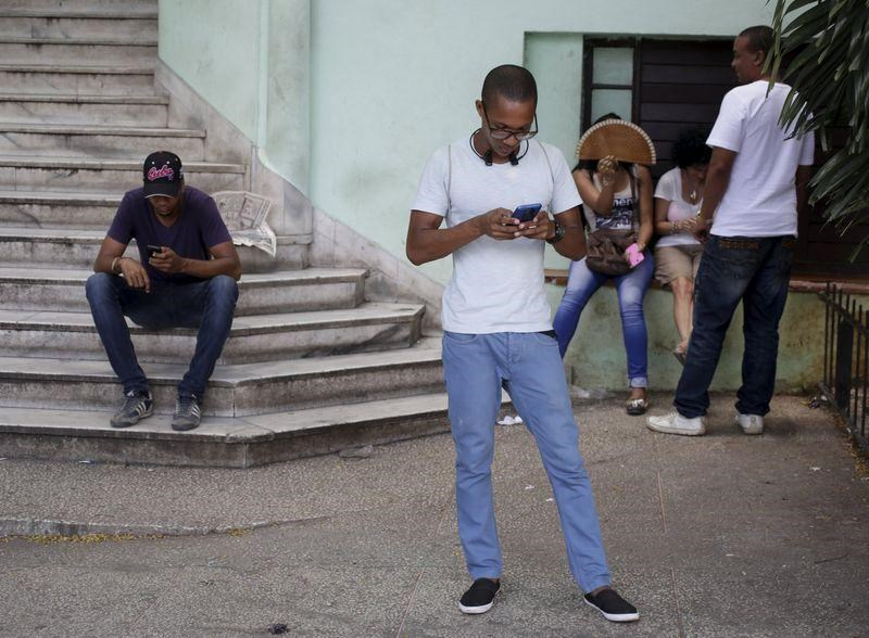 Cubans use the internet via public Wi-Fi in Havana July 2, 2015.
