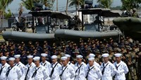 Philippine Marines and Navy sailors stand at attention during the navy's founding anniversary celebration at a naval station in Cavite city, on May 25, 2015