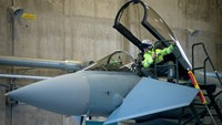 A Luftwaffe technician sits in the open cockpit of a Eurofighter Typhoon warplane at an airbase in Estonia. Photo: Bloomberg
