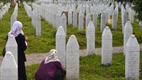 A Bosnian Muslim woman, a survivor of the Srebrenica massacre, at a memorial cemetery in village of Potocarion near the Eastern-Bosnian town of Srebrenica, on July 10, 2014