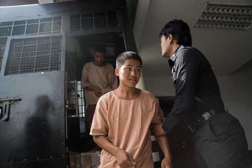 Myanmar national Win Zaw Tun (front) arrives at court for the start of his trial for the murder of two British holidaymakers, on the Thai resort island of Koh Samui on July 8, 2015
