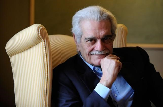 Egyptian actor Omar Sharif poses for a photograph during the presentation of his latest film entitled ''Disparadme'' at a hotel in Aviles, northern Spain, in this file photo from June 16, 2009.
