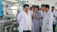 North Korean leader Kim Jong-Un (left) inspects the Pyongyang Bio-technical Institute, at the centre of the US allegations over anthrax.