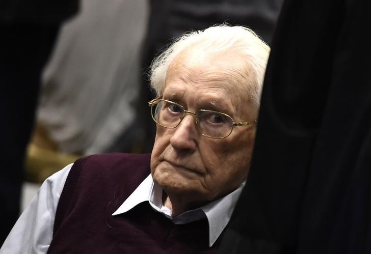 Oskar Groening, defendant and former Nazi SS officer dubbed the 'bookkeeper of Auschwitz', sits in the courtroom beside his advocate during his trial in Lueneburg, Germany, July 15, 2015.