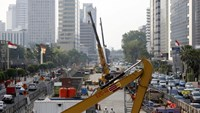 Workers using heavy machinery are seen constructing the new MRT line in central Jakarta, Indonesia July 2, 2015.