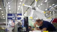 Aircraft technicians assemble S-92A helicopters at Sikorsky Global Helicopters in Coatesville, Pennsylvania October 16, 2014.