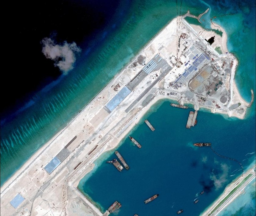 A handout photo taken on April 2, 2015 by satellite imagery provider DigitalGlobe shows a satellite image of what is claimed to be an under-construction airstrip at Fiery Cross Reef in the Spratly Islands, which is claimed by Vietnam, in the disputed South China Sea