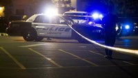 Police stand by at the scene outside the movie theatre where a man opened fire on film goers in Lafayette, Louisiana July 23, 2015.