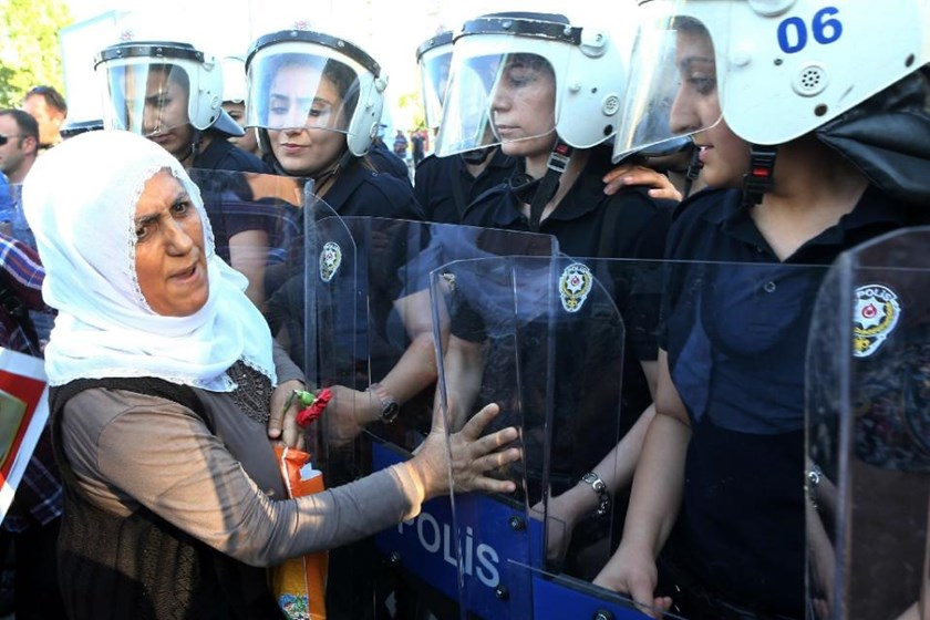 Members of the Peace Mothers face police officers during a protest on July 23, 2015 in Ankara to denounce a suicide bombing that killed 32 people in a Turkish town on the Syrian border, blamed on IS