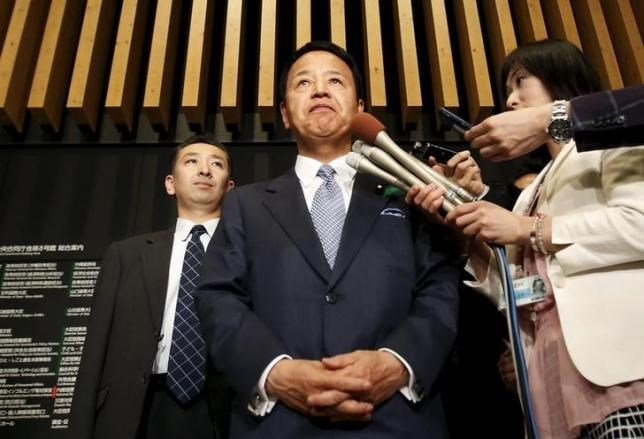 Japan's Economics Minister Akira Amari speaks to reporters after a meeting with U.S. Trade Representative Michael Froman in Tokyo April 19, 2015.