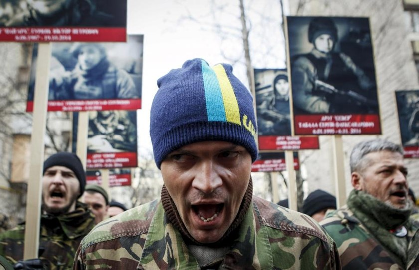 Activists of the Right Sector political party attend an anti-government march in Kiev, Ukraine, in this February 25, 2015 file photo.