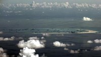An aerial photo taken though a glass window of a Philippine military plane shows the alleged on-going land reclamation by China on mischief reef in the Spratly Islands in the South China Sea, west of Palawan, Philippines, May 11, 2015