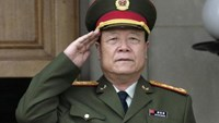 China's then-Central Military Commission former Vice Chairman General Guo Boxiong stands at attention during the playing of the national anthem before a meeting at the Pentagon in Washington July 18, 2006.