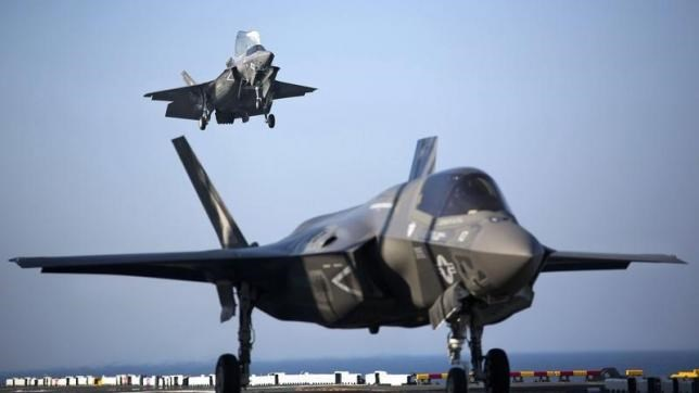 Two U.S. Marine F-35B Lightning II Joint Strike Fighters complete vertical landings aboard the USS Wasp (LHD-1) during operational testing May 18, 2015.