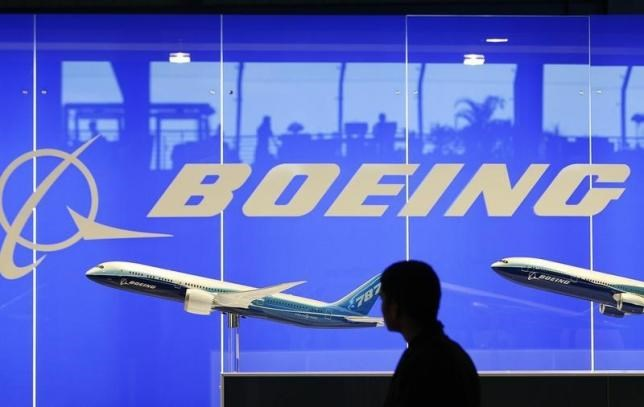 A man looks at a scale model of Boeing's 787 dreamliner at their booth at the Singapore Air Show in Singapore February 19, 2008.
