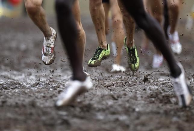 Competitors run during the men's senior race at the IAAF World Cross Country Championships in Bydgoszcz in this file photo taken on March 28, 2010.