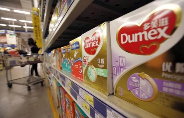 Dumex milk powder products of Danone are seen on display on shelves at a supermarket in Beijing, February 17, 2014.