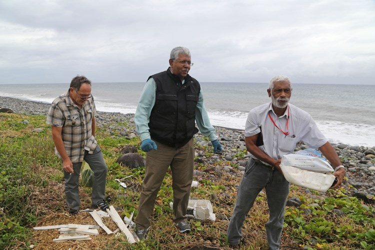Searchers look for debris from the MH370 airplane on Reunion Island in the Indian Ocean, on August 4, 2015. Photographer: Richard Bouhet/AFP/Getty Images