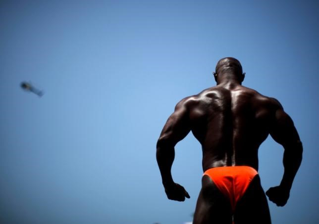 A man competes at the Muscle Beach Independence Day bodybuilding contest on Venice Beach in Los Angeles, California, July 4, 2013.