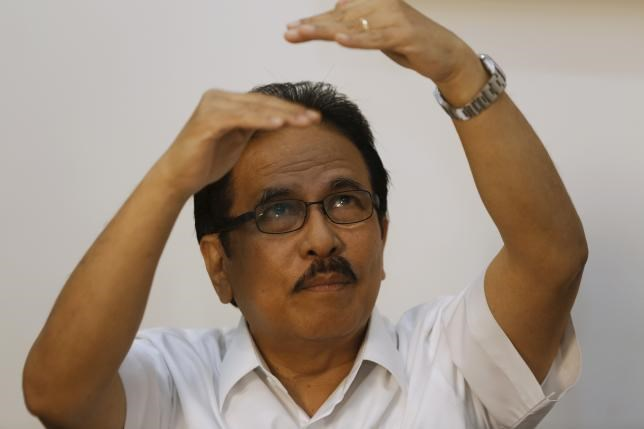 Indonesian Coordinating Minister for Economics Sofyan Djalil gestures during an interview at his office in Jakarta, August 7, 2015.